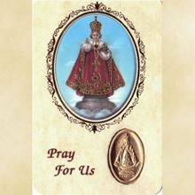 Picture of Infant of Prague prayer card and medal